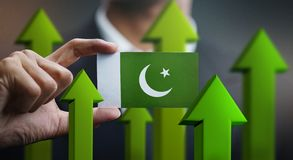 Nation Growth Concept, Green Up Arrows - Businessman Holding Car. D Pakistan Flag royalty free illustration