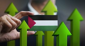 Nation Growth Concept, Green Up Arrows - Businessman Holding Car. D Palestine Flag royalty free illustration