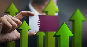 Nation Growth Concept, Green Up Arrows - Businessman Holding Car. D Qatar Flag stock illustration