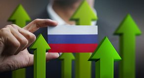 Nation Growth Concept, Green Up Arrows - Businessman Holding Car. D Russia Flag stock illustration
