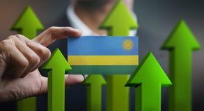 Nation Growth Concept, Green Up Arrows - Businessman Holding Car. D Rwanda Flag stock illustration