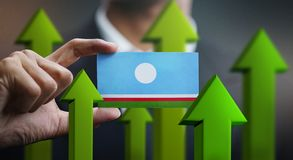 Nation Growth Concept, Green Up Arrows - Businessman Holding Car. D of Sakha Republic Flag stock illustration