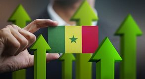 Nation Growth Concept, Green Up Arrows - Businessman Holding Car. D of Senegal Flag stock illustration