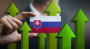 Nation Growth Concept, Green Up Arrows - Businessman Holding Car. D of Slovakia Flag vector illustration