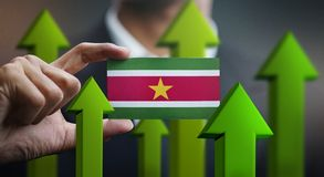 Nation Growth Concept, Green Up Arrows - Businessman Holding Car. D of Suriname Flag stock illustration