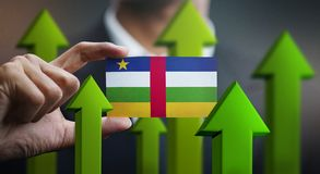 Nation Growth Concept, Green Up Arrows - Businessman Holding Car royalty free stock photo