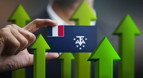 Nation Growth Concept, Green Up Arrows - Businessman Holding Car. D of French Southern Flag royalty free illustration