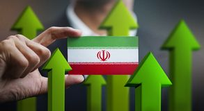 Nation Growth Concept, Green Up Arrows - Businessman Holding Car. D of Iran Flag stock illustration