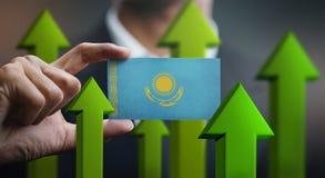 Nation Growth Concept, Green Up Arrows - Businessman Holding Car. D of Kazakhstan Flag stock illustration
