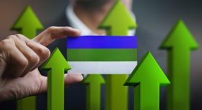 Nation Growth Concept, Green Up Arrows - Businessman Holding Car. D of Komi Republic Flag stock illustration