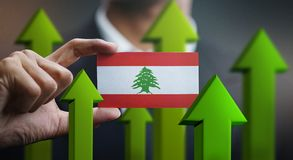 Nation Growth Concept, Green Up Arrows - Businessman Holding Car. D of Lebanon Flag royalty free illustration
