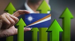 Nation Growth Concept, Green Up Arrows - Businessman Holding Car. D of Marshall Islands Flag stock illustration