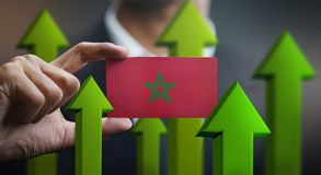 Nation Growth Concept, Green Up Arrows - Businessman Holding Car. D of Morocco Flag royalty free illustration