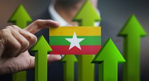 Nation Growth Concept, Green Up Arrows - Businessman Holding Car. D of Myanmar Flag royalty free illustration