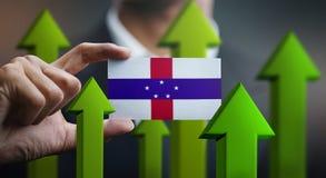Nation Growth Concept, Green Up Arrows - Businessman Holding Car. D of Netherlands Antilles Flag vector illustration