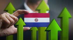 Nation Growth Concept, Green Up Arrows - Businessman Holding Car. D Paraguay Flag stock illustration