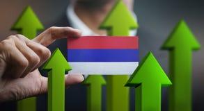 Nation Growth Concept, Green Up Arrows - Businessman Holding Car. D Republika Srpska Flag stock illustration
