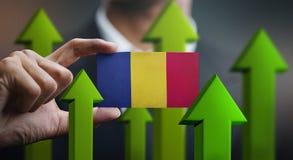 Nation Growth Concept, Green Up Arrows - Businessman Holding Car. D Romania Flag vector illustration