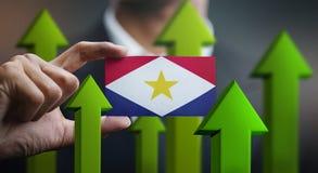 Nation Growth Concept, Green Up Arrows - Businessman Holding Car. D of Saba Flag vector illustration