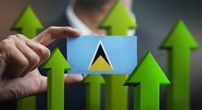 Nation Growth Concept, Green Up Arrows - Businessman Holding Car. D of Saint Lucia Flag vector illustration