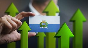 Nation Growth Concept, Green Up Arrows - Businessman Holding Car. D of San Marino Flag stock illustration