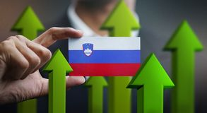 Nation Growth Concept, Green Up Arrows - Businessman Holding Car. D of Slovenia Flag stock illustration