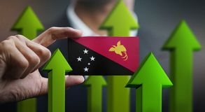 Nation Growth Concept, Green Up Arrows - Businessman Holding Car. D Papua New Guinea Flag royalty free illustration