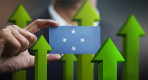 Nation Growth Concept, Green Up Arrows - Businessman Holding Car. D of Federated States of Micronesia Flag stock illustration