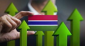 Nation Growth Concept, Green Up Arrows - Businessman Holding Car. D of The Gambia Flag stock illustration