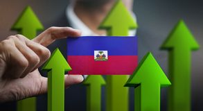 Nation Growth Concept, Green Up Arrows - Businessman Holding Car. D of Haiti Flag royalty free illustration