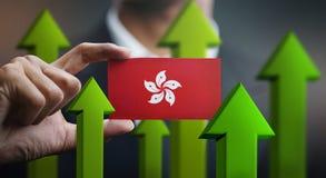 Nation Growth Concept, Green Up Arrows - Businessman Holding Car. D of Hong Kong Flag vector illustration