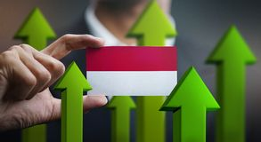 Nation Growth Concept, Green Up Arrows - Businessman Holding Car. D of Indonesia Flag stock illustration