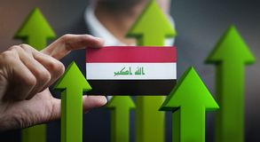 Nation Growth Concept, Green Up Arrows - Businessman Holding Car. D of Iraq Flag vector illustration