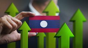 Nation Growth Concept, Green Up Arrows - Businessman Holding Car. D of Laos Flag stock illustration