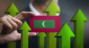 Nation Growth Concept, Green Up Arrows - Businessman Holding Car. D of Maldives Flag stock illustration