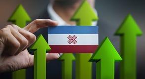 Nation Growth Concept, Green Up Arrows - Businessman Holding Car. D of Mari El Flag royalty free illustration