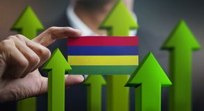 Nation Growth Concept, Green Up Arrows - Businessman Holding Car. D of Mauritius Flag stock illustration