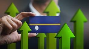 Nation Growth Concept, Green Up Arrows - Businessman Holding Car. D of Nauru Flag vector illustration