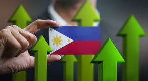 Nation Growth Concept, Green Up Arrows - Businessman Holding Car. D Philippines Flag royalty free illustration