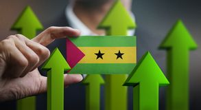 Nation Growth Concept, Green Up Arrows - Businessman Holding Car. D of São Tomé and Príncipe Flag vector illustration