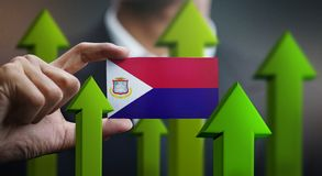 Nation Growth Concept, Green Up Arrows - Businessman Holding Car. D of Saint Martin Flag stock illustration
