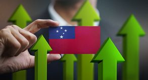 Nation Growth Concept, Green Up Arrows - Businessman Holding Car. D of Samoa Flag royalty free illustration