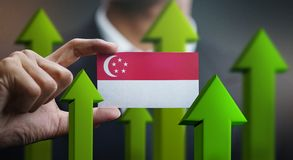 Nation Growth Concept, Green Up Arrows - Businessman Holding Car. D of Singapore Flag vector illustration