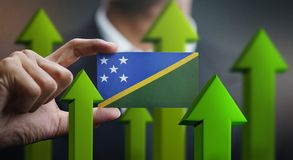 Nation Growth Concept, Green Up Arrows - Businessman Holding Car. D of Solomon Islands stock images