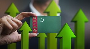 Nation Growth Concept, Green Up Arrows - Businessman Holding Car. D of Turkmenistan Flag royalty free stock image