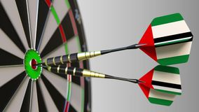 National achievement. Flags of the United Arab Emirates UAE on darts hitting bullseye. Conceptual animation. National achievement. Flags of the United Arab stock video footage