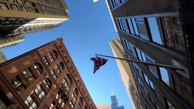 National flags on buildings in downtown Manhattan stock video footage