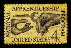National Apprenticeship Program of USA. UNITED STATES - CIRCA 1962: A stamp printed in USA symbolizes the transfer of knowledge micrometer with inscription ` Royalty Free Stock Photos