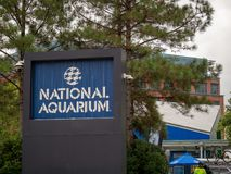 National Aquarium logo sign on the Baltimore Inner Harbor royalty free stock images