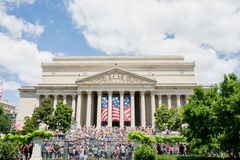National Archives of the United States. Photograph of a large audience in front of the Archives on July 4th, 2014. People gathered along constitution avenue to Stock Images